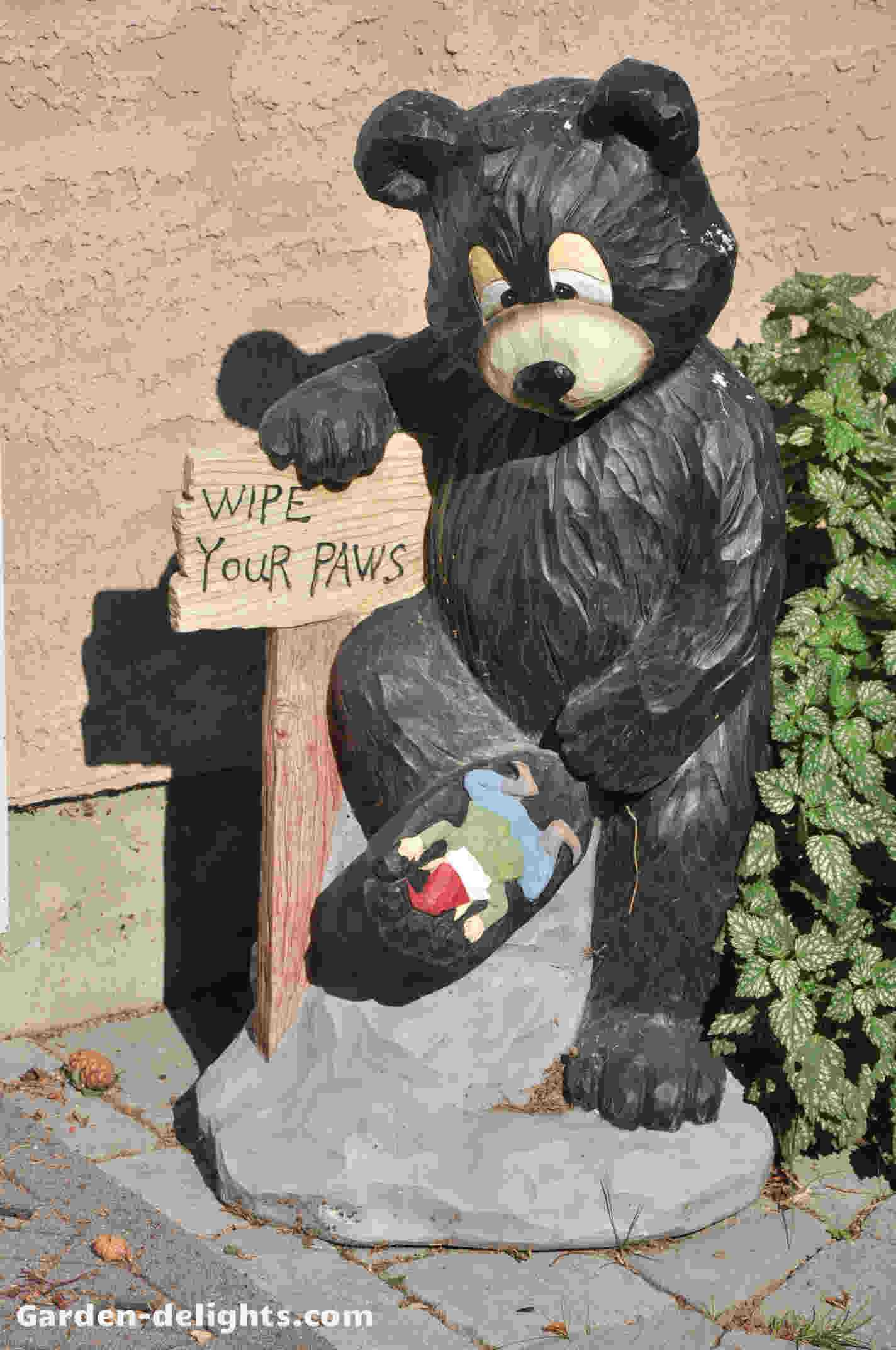 Bear Garden Statue With One Foot Up With Garden Gnome Underneath His Foot  With A Sign