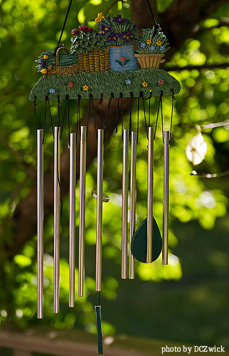 Small tubular ceramic wide wind chimes with four flower baskets filled with  colorful(yellow,