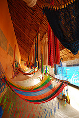 Colorful hammocks hung in a row,rope hammocks, patio hammocks.