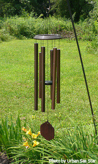 Copper wind chimes weathered with a dark brown color on decorative shepherds hook, contemporary wind chimes, large tube wind chimes.