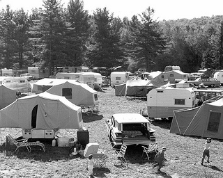 Folding Outdoor Furniture, historic campground with tents trailer's in 1961 with kids running by trailers and a car.