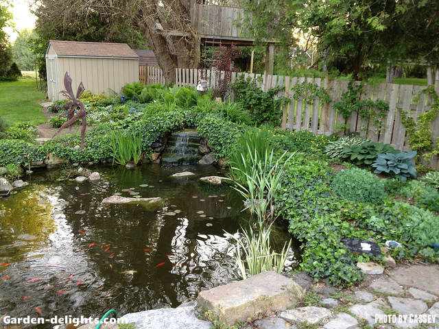 Building a backyard pond design size pond building garden for Large pond waterfall