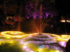 Outdoor fountains spraying in the air with colorful lights, lighted outdoor water fountains, outdoor fountain lights.