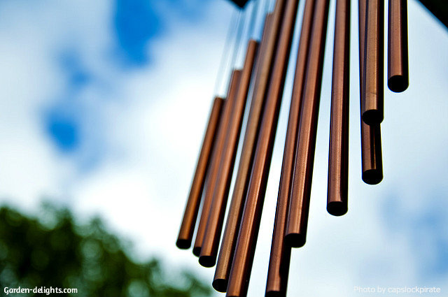Long copper wind chimes, Dark bronze color copper chimes hanging down from gazebo overhang