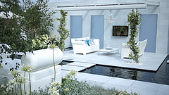 Modern Outdoor Furniture, two white loveseat with coffee table in court yard with water in patio floor.