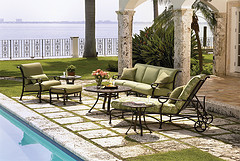 Outdoor furniture sets, outdoor furniture set by pool with couch, chair, ottoman and lounging chair in green and brown.