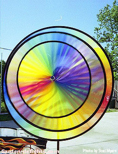 Triple multicolored nylon wind spinner spinning multiple colors, purple, yellow, red, green in garden, wholesale wind spinners.
