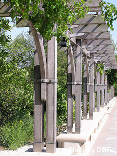 Multiple arbors with Pergola tops with vines and flowers, large garden arbors, small garden arbors.