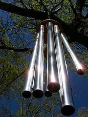 Long tube metal wind chimes hanging from the tree, windchimes.