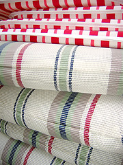Outdoor Furniture Cushions, striped red and white patio furniture cushions stacked.