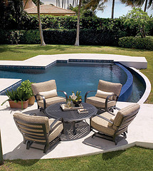 outdoor furniture tips, four piece Wicker patio furniture set in front of pool on patio.