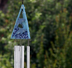 Blue dolphin wind chimes hung on a tree,Outdoor wind chimes,garden wind chimes.