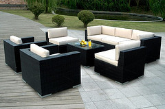 Outdoor Wood furniture, seven piece Wicker outdoor living furniture set with white cushions and center table.