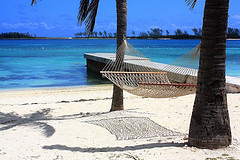 Hammock hung on beach with dock in background,Portable Hammocks,Hammocks.