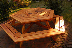Red Cedar Outdoor Furniture, Hexagon Cedar Picnic Table On Brick Patio.