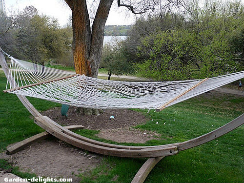 white hand woven cotton hammock mounted on wooden hammocks stand in relaxing backyard garden  relaxing hammocks with stands hammock setschairsswings garden delights    rh   garden delights
