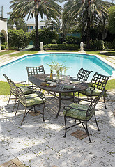 Aluminum Outdoor Furniture, seven piece metal outdoor furniture set by the pool.