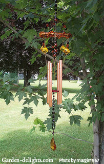 Small copper wind chimes with beads and stained-glass diamond wind catcher with bamboo ring top, modern tuned wind chimes, illuminated wind chimes.