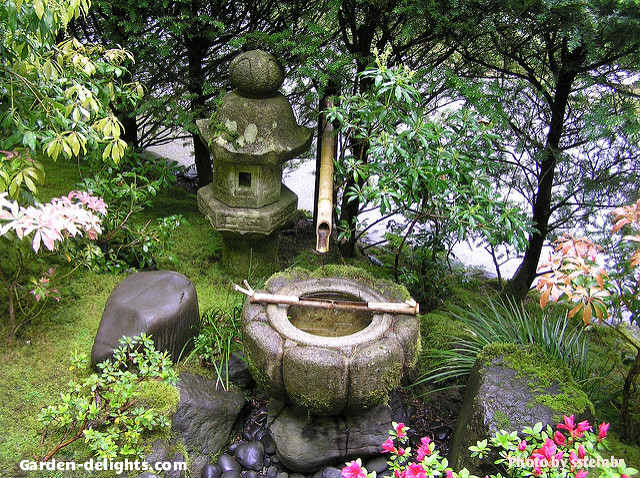 Small Stone Anese Water Fountain In Garden With Bamboo Reed Pouring Into Bowl And