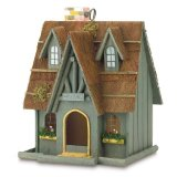 A cute Thatch Roof Chimney wood cottage birdhouse with a 2 1/8 inch x 2 7/8 inch door with a high peak roof, decorative birdhouse,, fancy birdhouses.